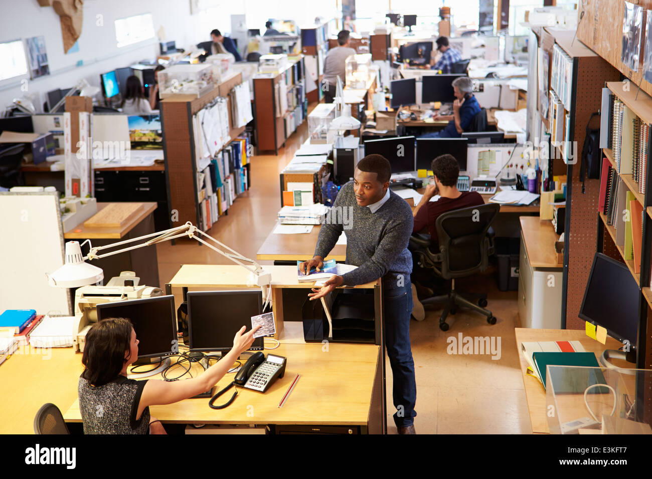 Interior Of Busy Architect's Office With Staff Working - Stock Image