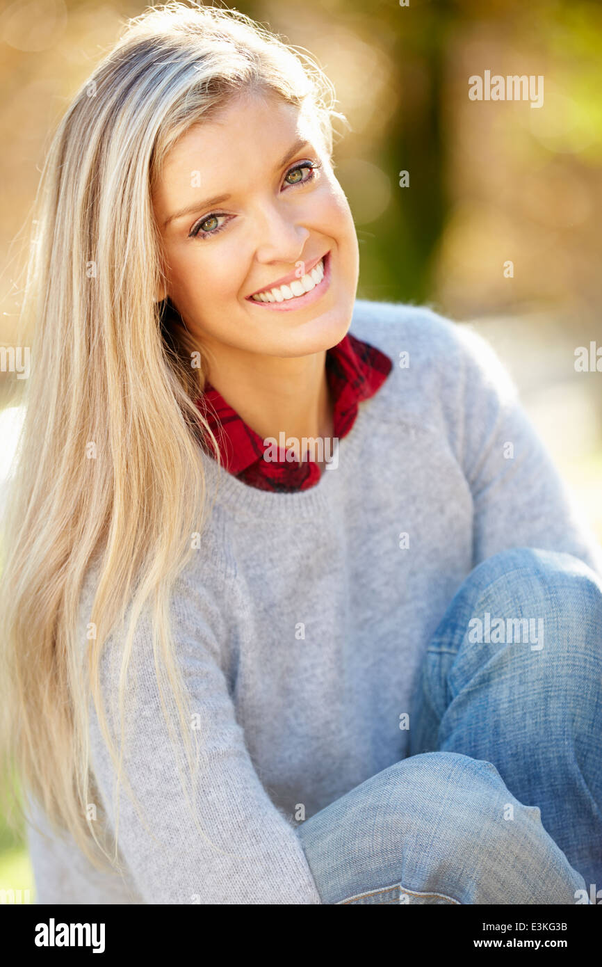 Portrait Of Attractive Woman In Countryside - Stock Image