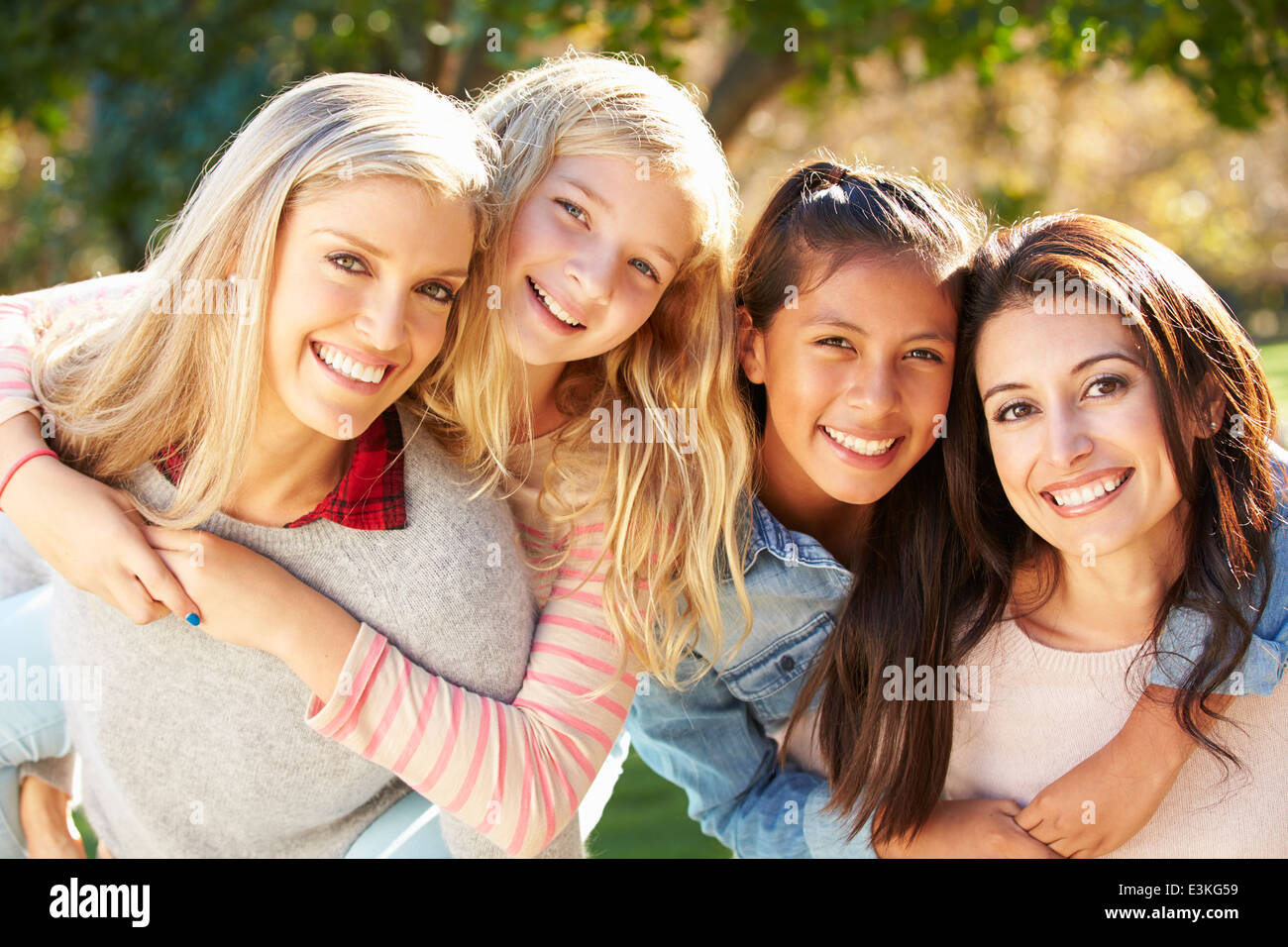 Portrait Of Two Mothers With Daughters - Stock Image