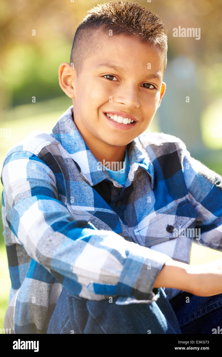 Portrait Of Hispanic Boy In Countryside - Stock Image