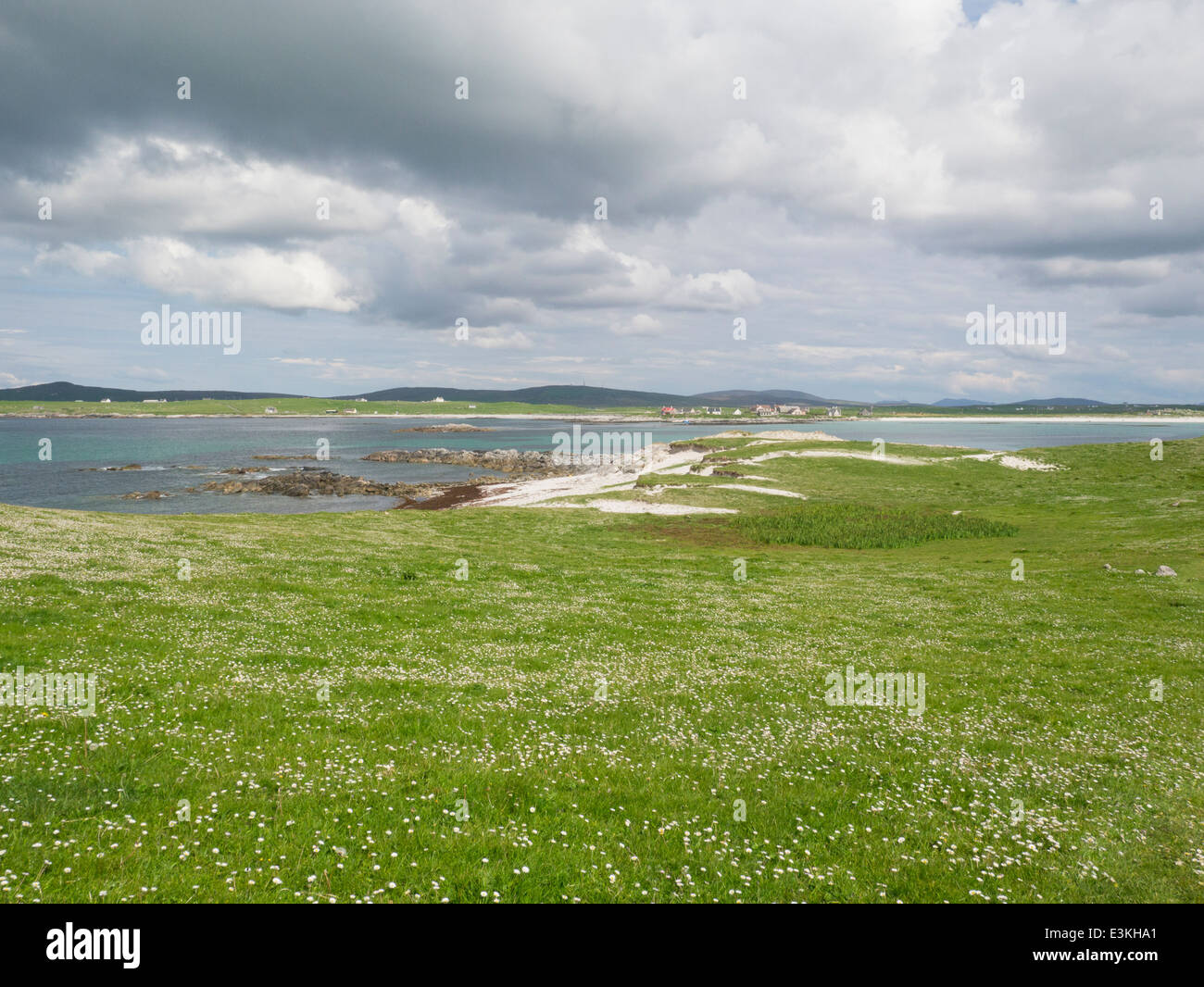 View across white sandy beach of Loch  Paibeil to village North Uist Outer Hebrides Western Isles - Stock Image
