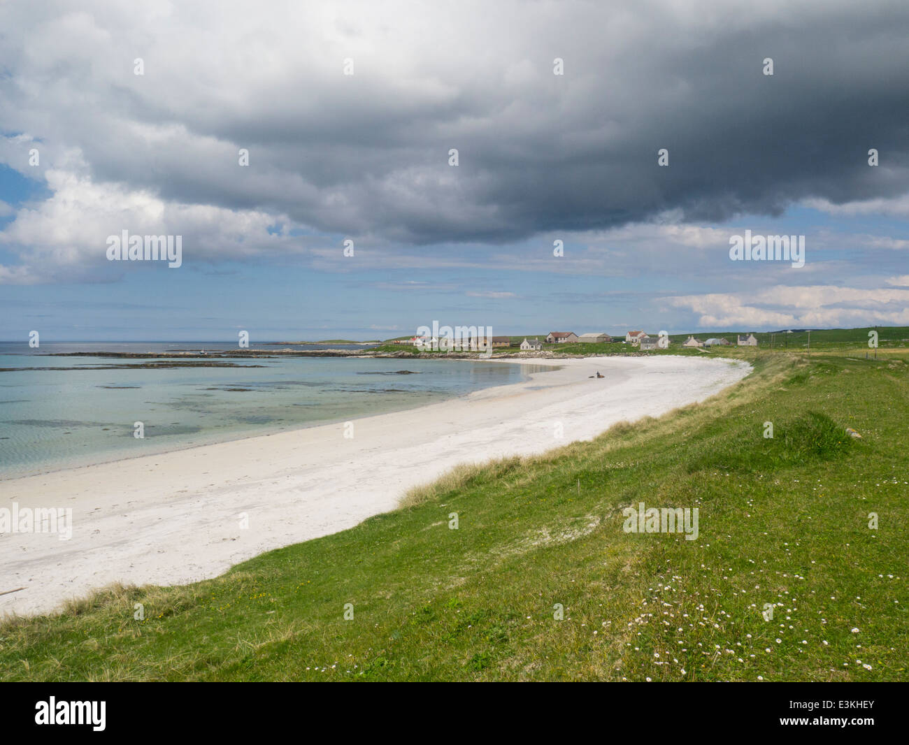 View across white sandy beach Port Scalpaig to Paibeil village North Uist Outer Hebrides Western Isles - Stock Image
