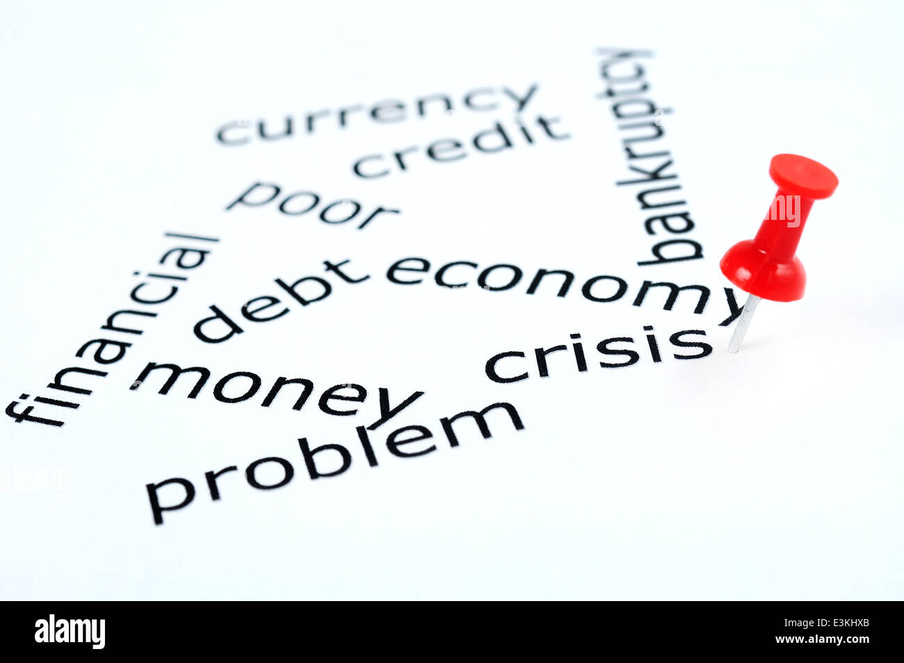Crisis word pinned on paper - Stock Image