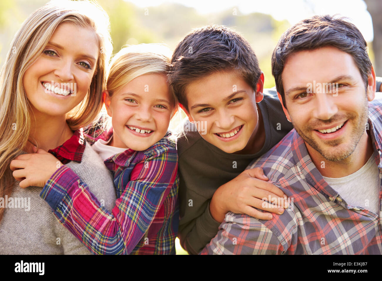 Portrait Of Family In Countryside Stock Photo