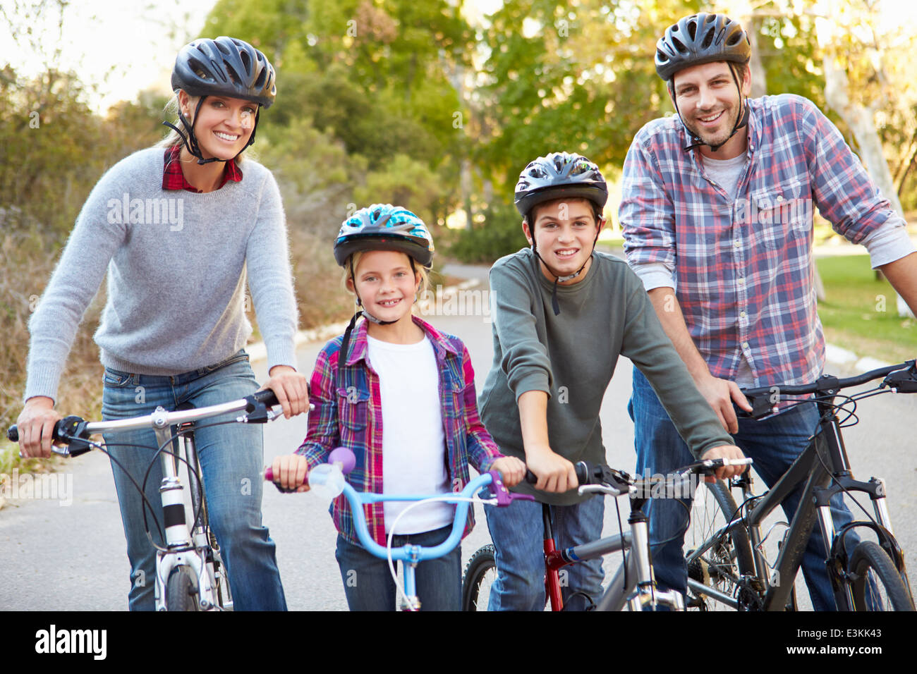 Portrait Of Family On Cycle Ride In Countryside - Stock Image