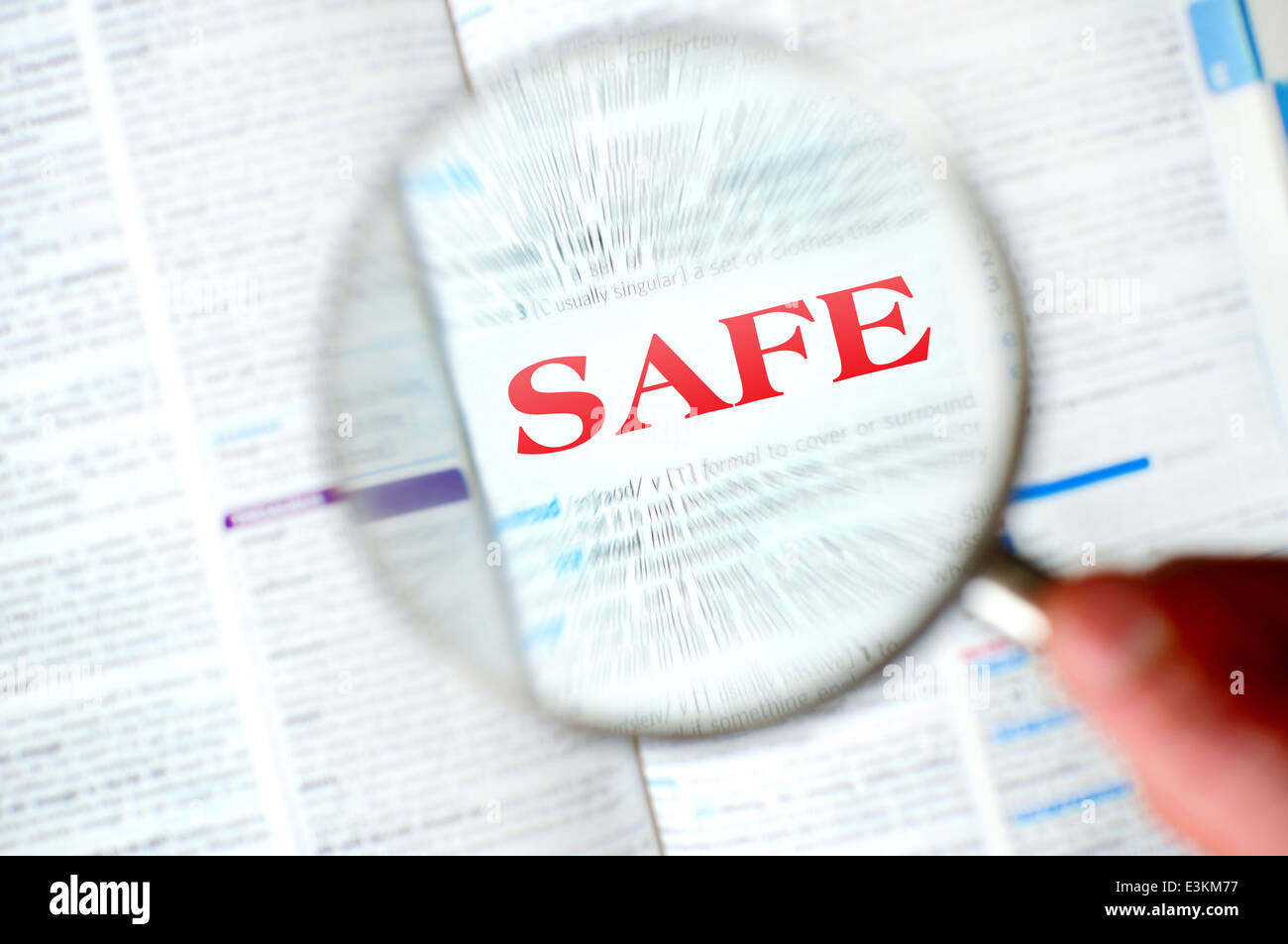 Magnifying safe word from book - Stock Image