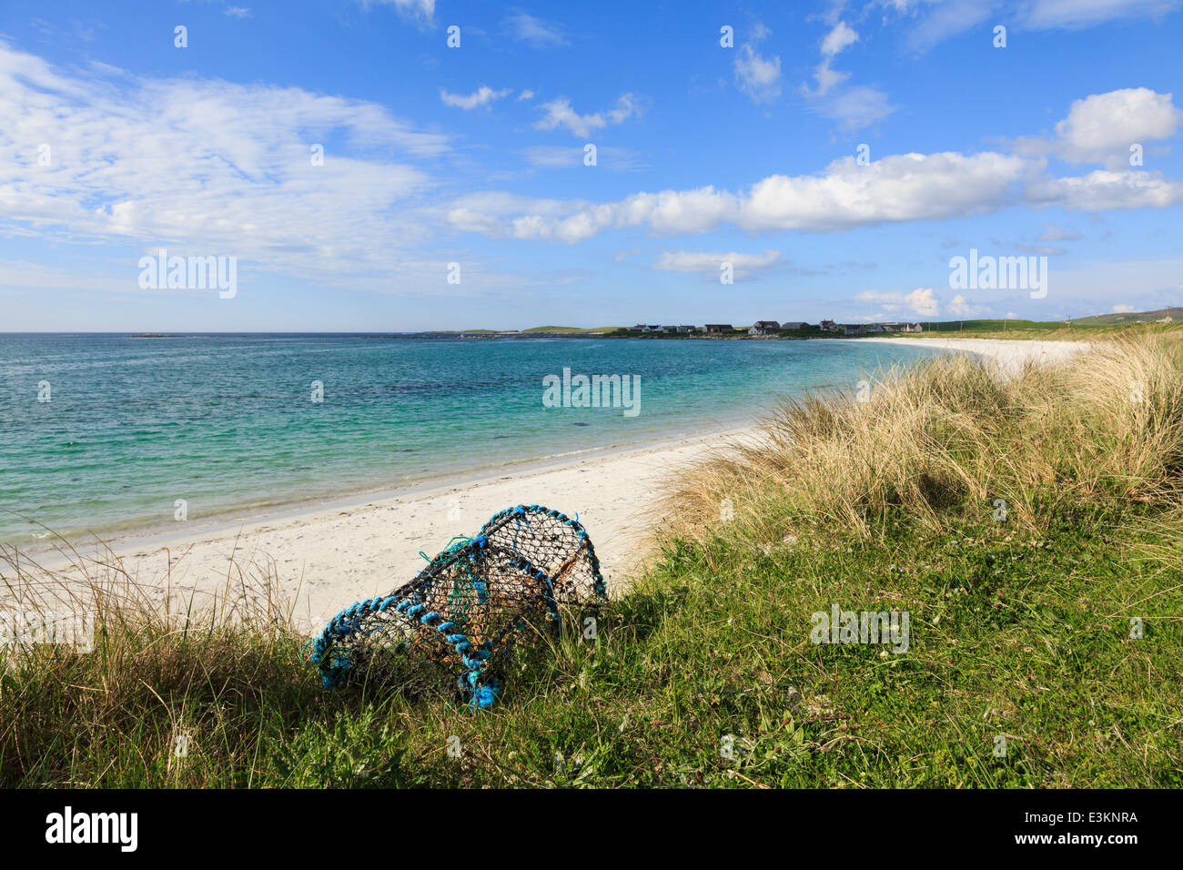 Lobster pot on sand dunes by Traigh nam Faoghailean beach Balranald RSPB Nature Reserve North Uist Outer Hebrides - Stock Image