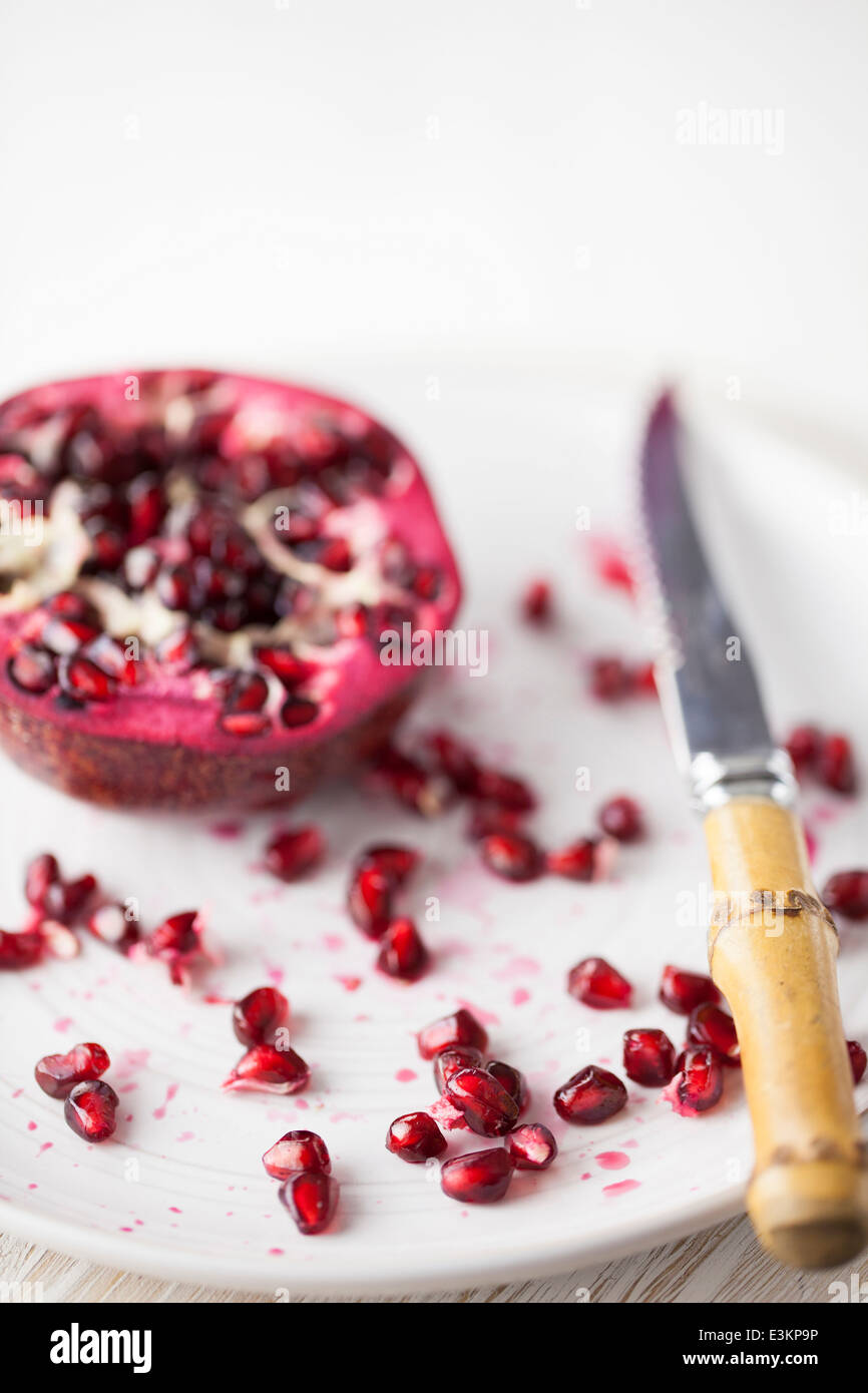 Pomegranate Seeds on Plate - Stock Image