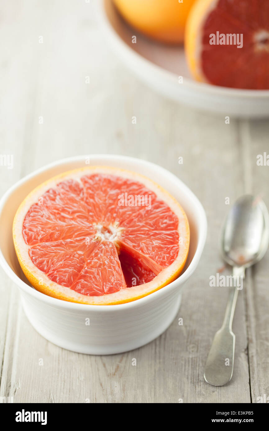 Grapefruit Half in White Bowl with Spoon - Stock Image