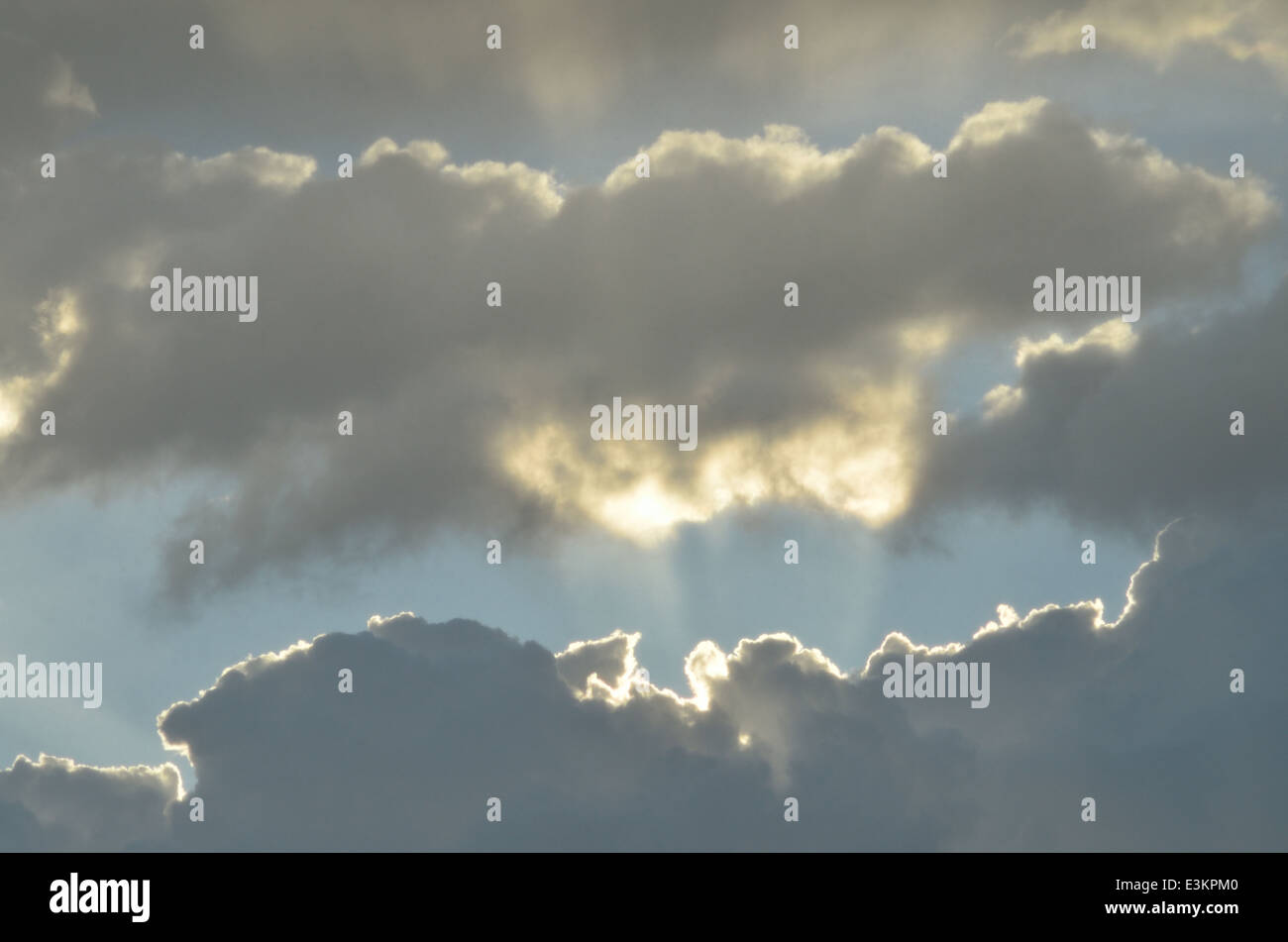 Clouds and sunrays - Stock Image