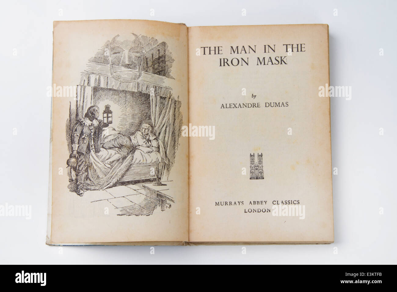Illustration and title page of a 1950s Abbey Classic novel entitled The Man In The Iron Mask - Stock Image