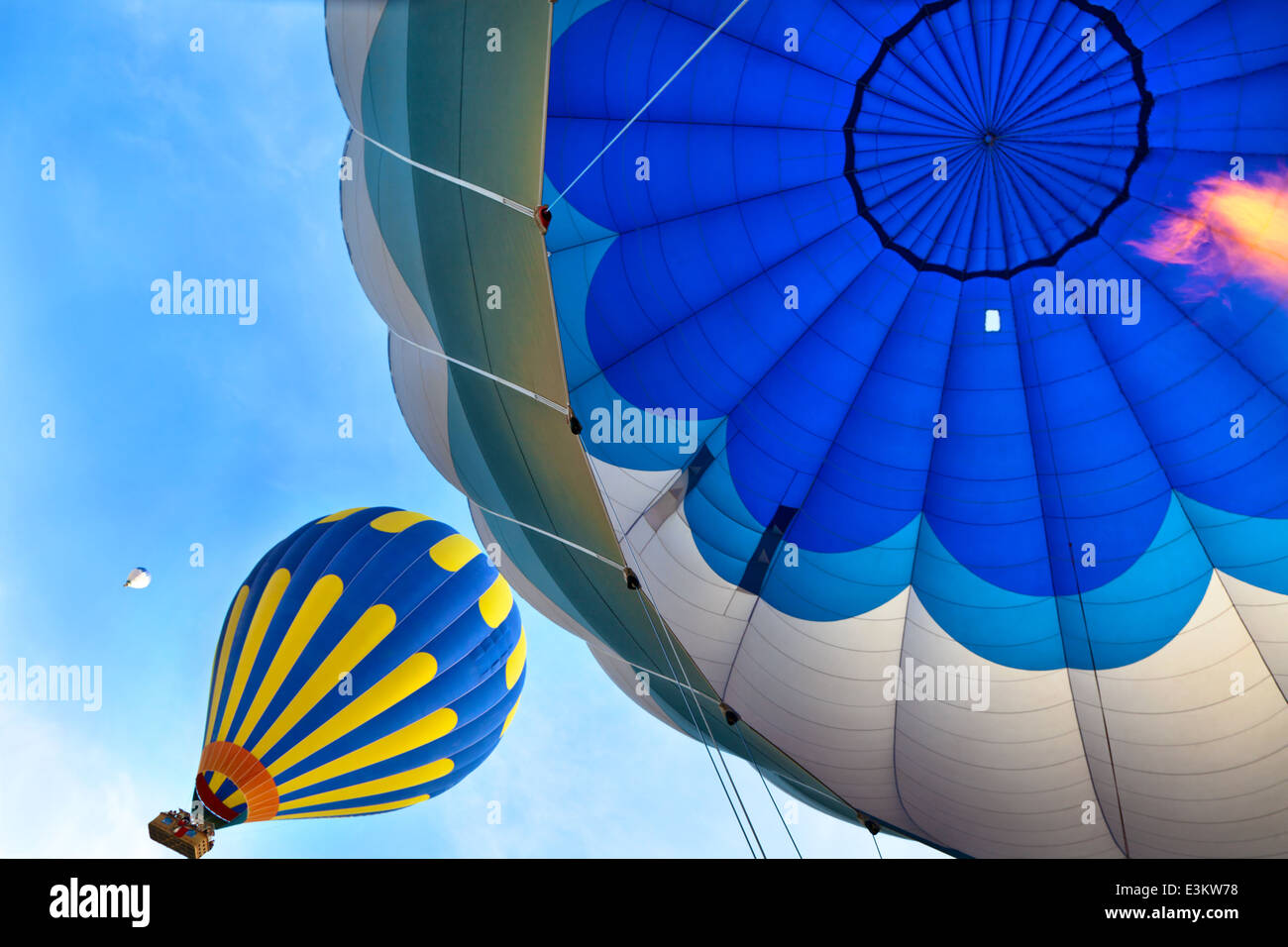 view of top of hot air balloon with burning flame - Stock Image