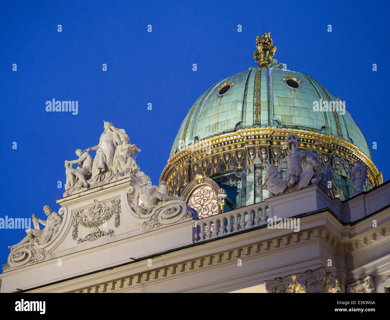 Gilded Copper dome over the Hofburg Palace. Floodlit dome at one of the entrances to the huge palace complex. - Stock Image
