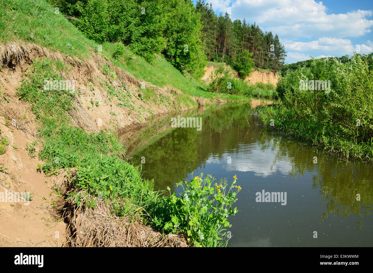 Steep coast of the twisting river - Stock Image