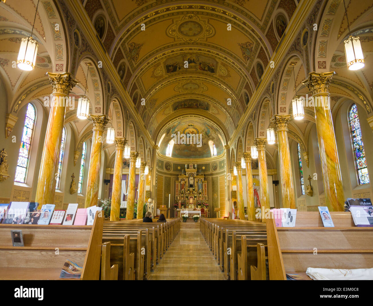 Centre Aisle of St Stanislaus RC Polish Church. The ornate and highly decorated interior of this Polish community - Stock Image