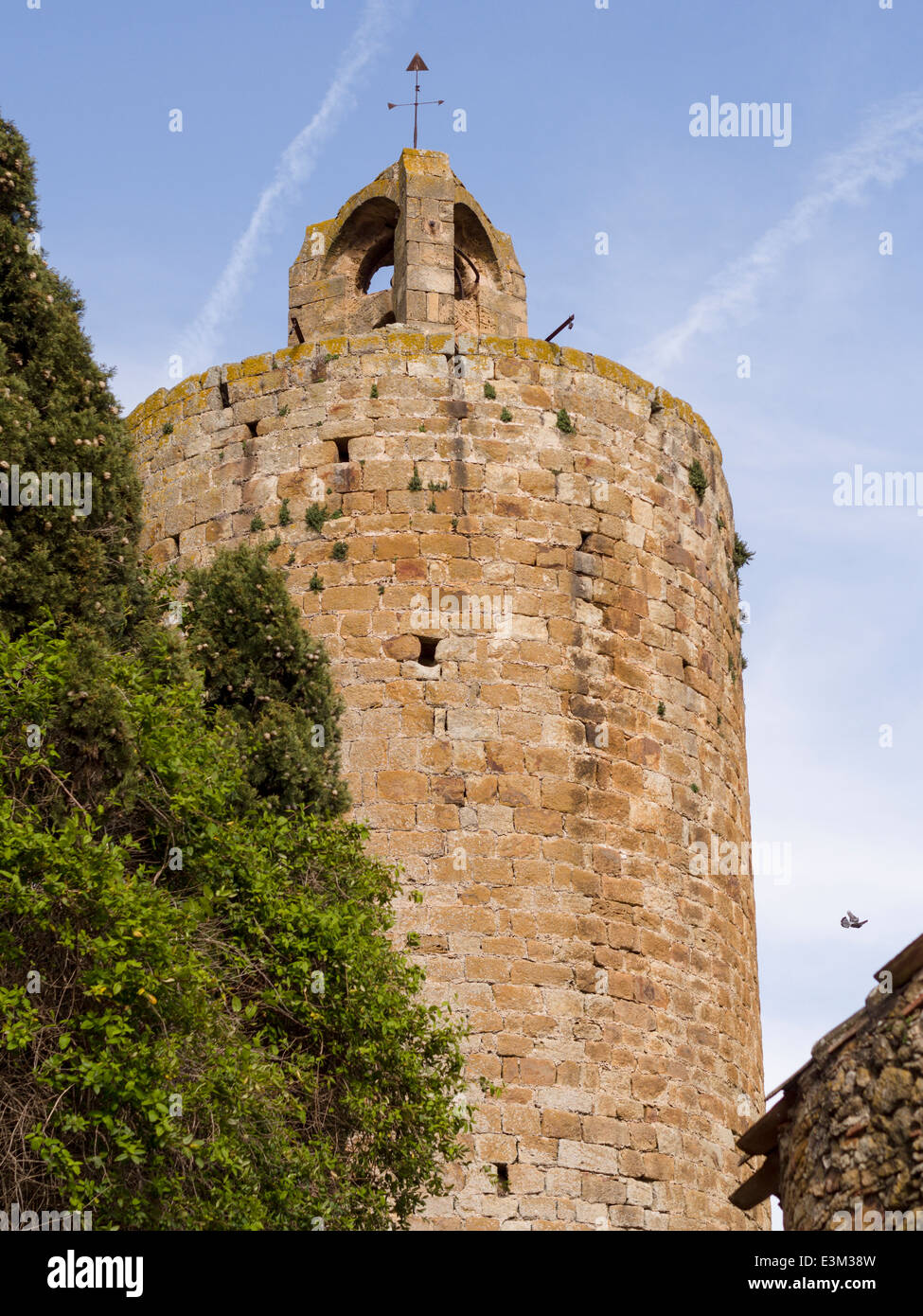 Pals watch tower an ancient fortification. An old stone tower is an ongoing reminder of the fortifications in this - Stock Image