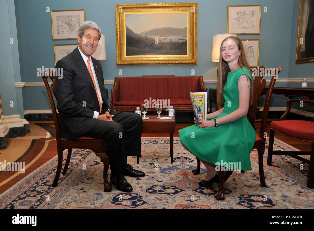 Secretary Kerry Poses With National Geographic Kids Reporter Moore - Stock Image