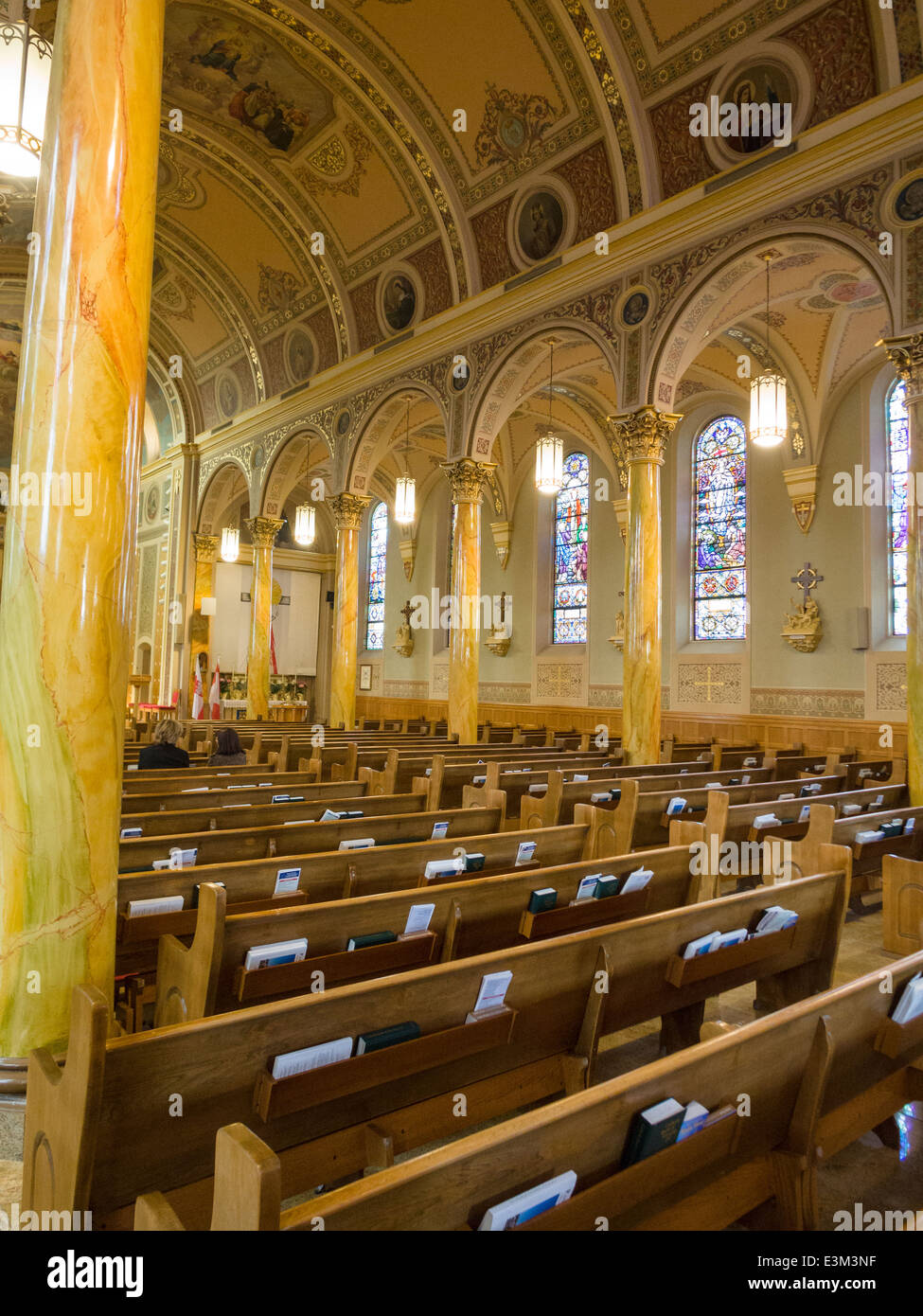 Centre and Right Aisle of St Stanislaus RC Polish Church. The ornate and highly decorated interior of this community - Stock Image