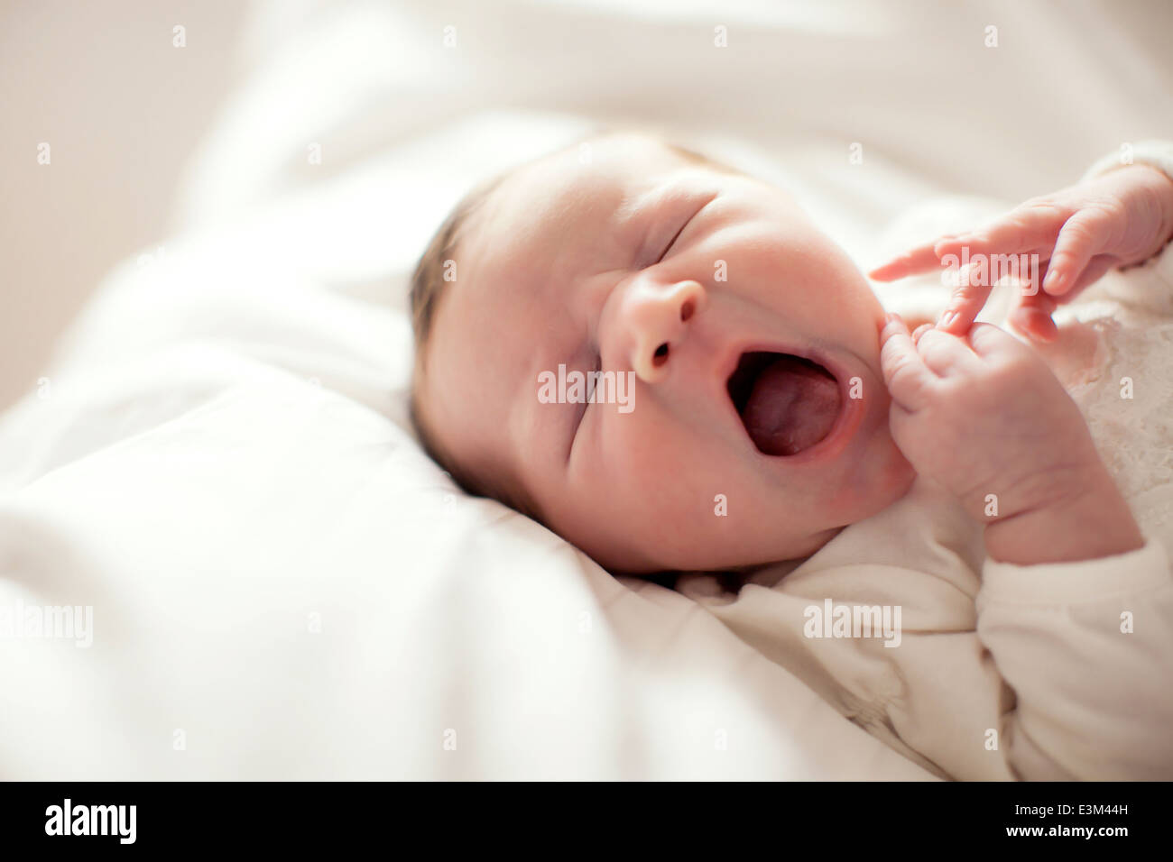 Yawning baby girl (0-1 month) Stock Photo