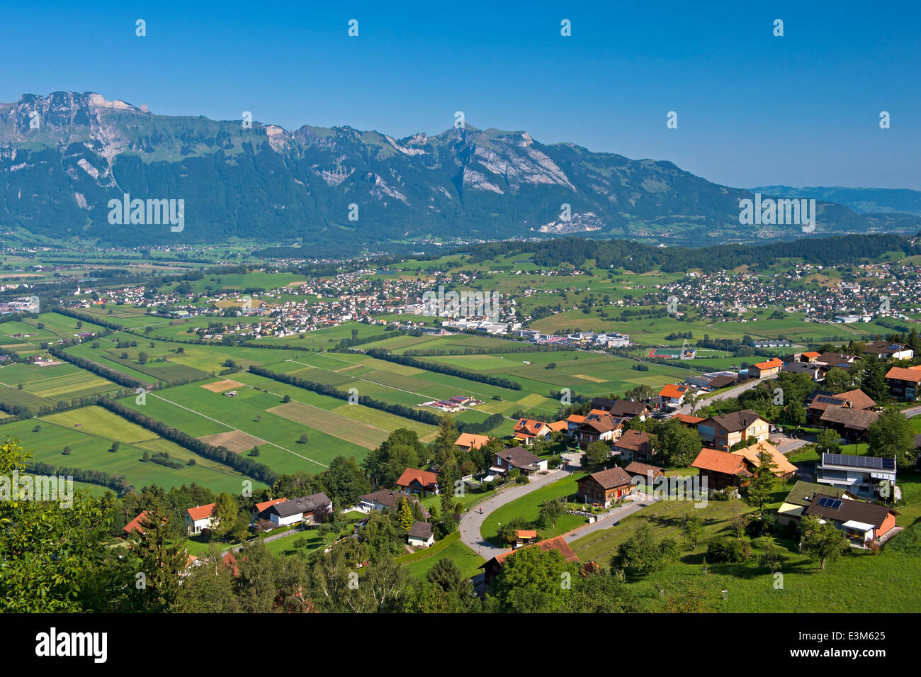 View from Planken across the Rhine valley to the Alpstein mountain range, Principality of Liechtenstein - Stock Image