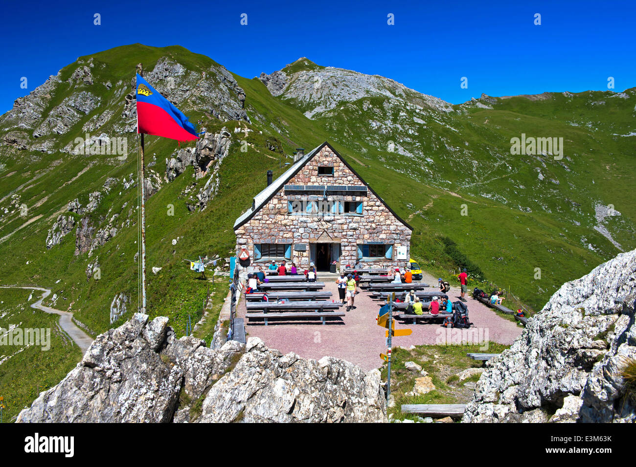 Mountain hut Pfaelzerhuette with the flag of Liechtenstein, Raetikon mountain range, Principality of Liechtenstein - Stock Image