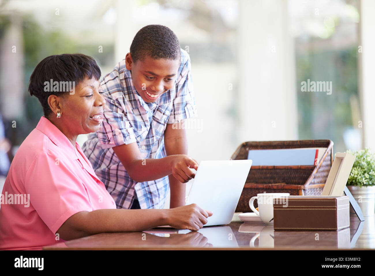 Grandson Helping Grandmother With Laptop - Stock Image