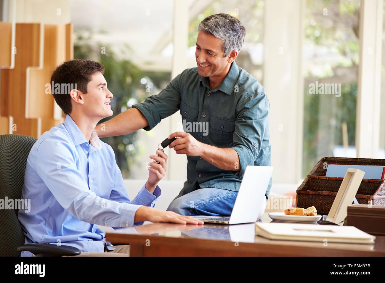 Father Giving Teenage Son Car Keys - Stock Image