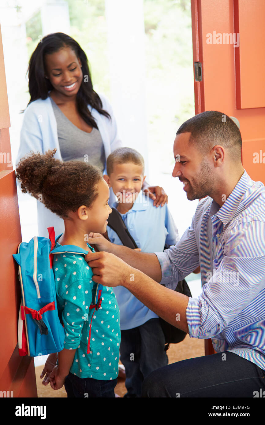 Father Saying Goodbye To Children As They Leave For School - Stock Image