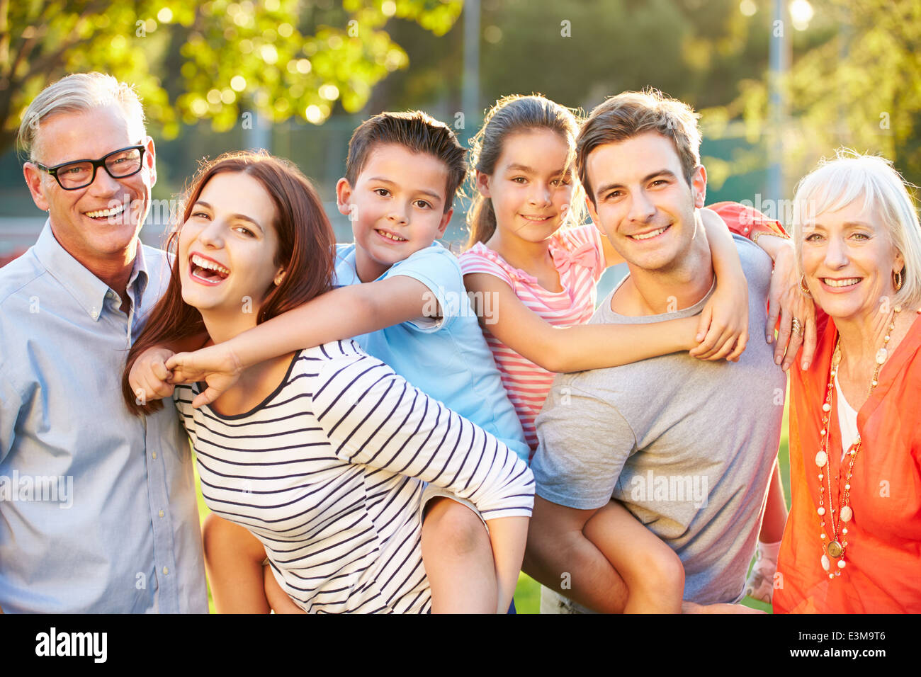 Outdoor Portrait Of Multi-Generation Family In Park - Stock Image