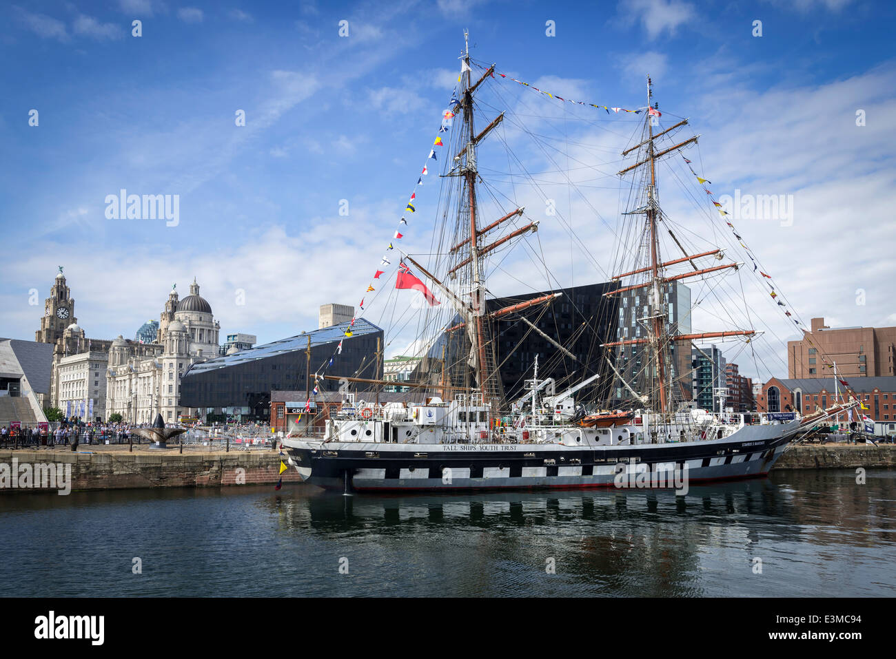 The Stavros S Niarchos tall ship berthed in Liverpool's Canning Dock at the pierhead. - Stock Image