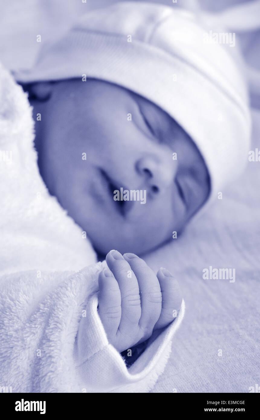 Little newborn baby (1 week old) sleeps.(BW) - Stock Image