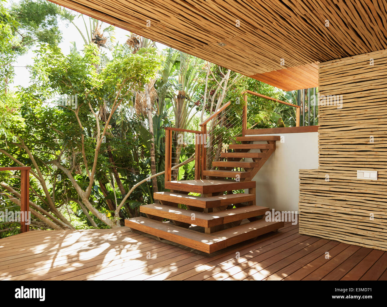 Wooden stairs and deck - Stock Image
