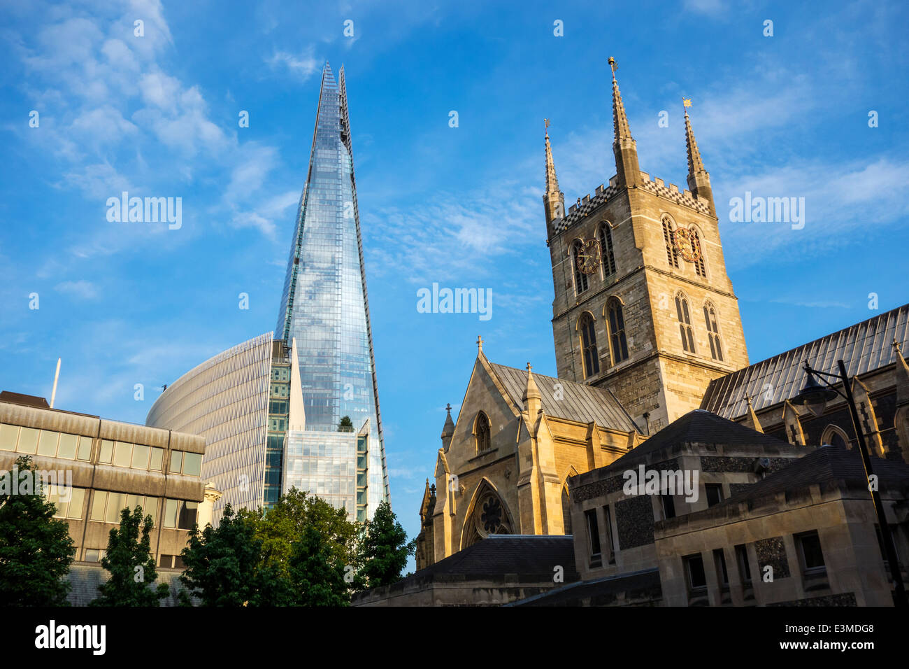 The Shard Southwark Cathedral Old and New London.  The Shard blending with the sky which was a design feature. - Stock Image