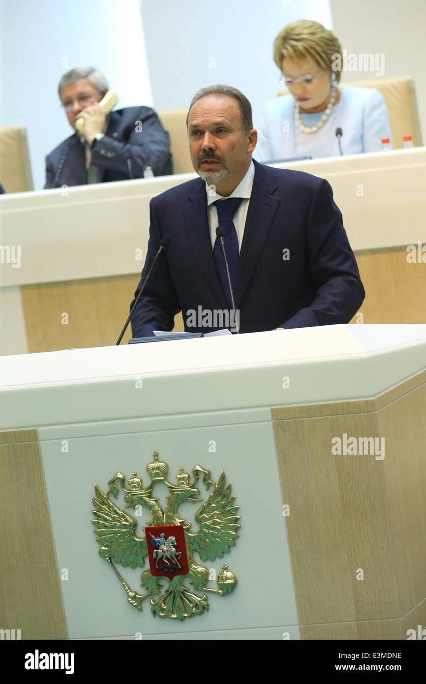 Moscow, Russia. 25th June, 2014. Russia's housing and utilities minister Mikhail Men speaks during the question - Stock Image