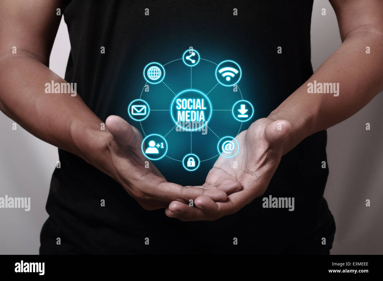 Hand showing social media icons. - Stock Image