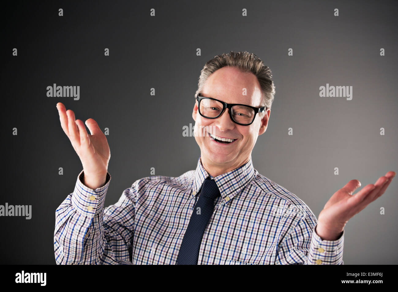 Portrait of happy businessman gesturing - Stock Image