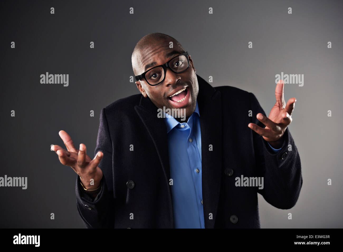 Portrait of businessman shrugging - Stock Image