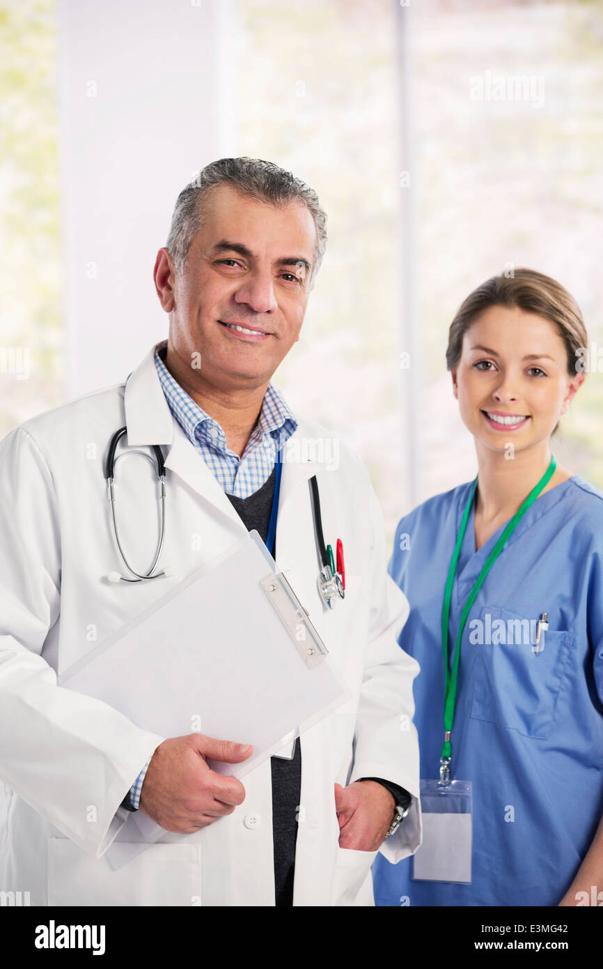 Portrait of smiling doctor and nurse - Stock Image