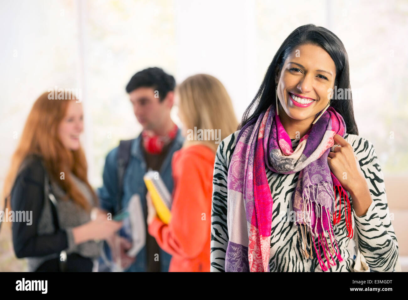Portrait of confident college student - Stock Image