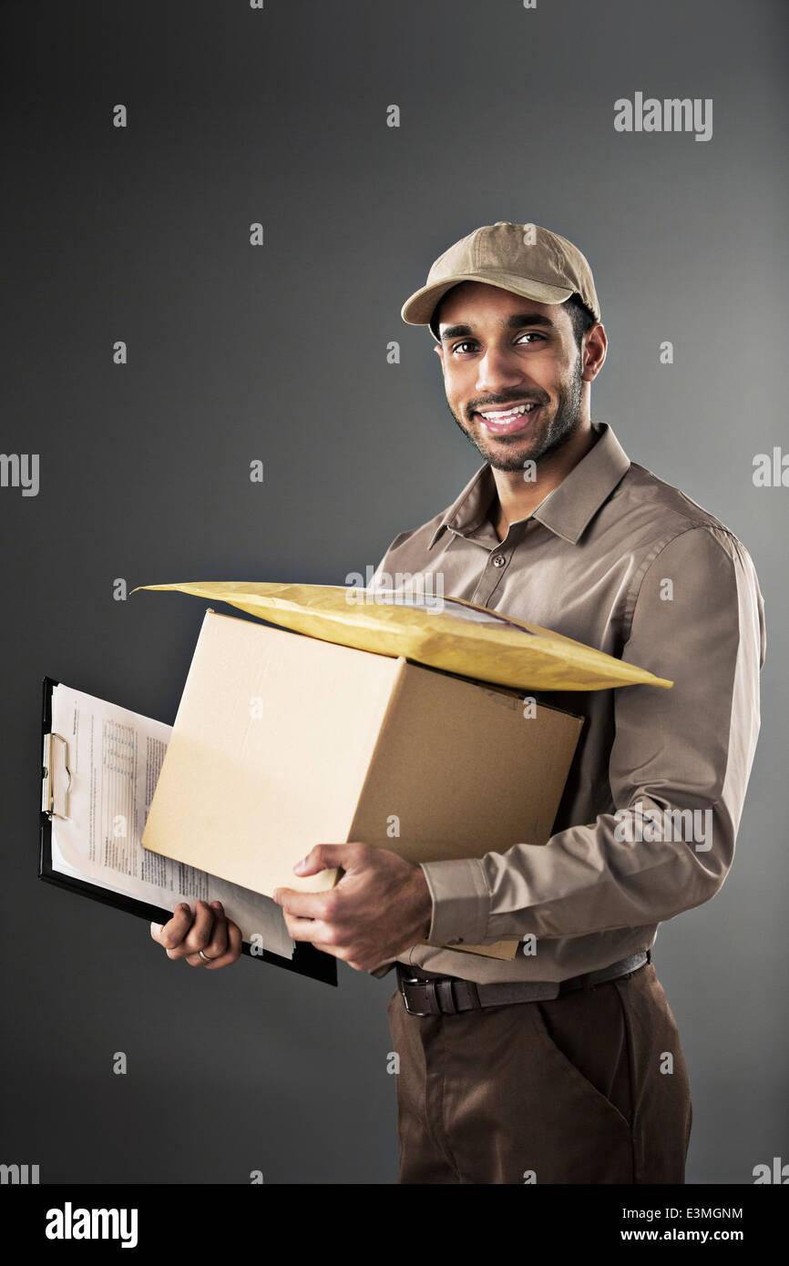 Portrait of confident deliveryman - Stock Image
