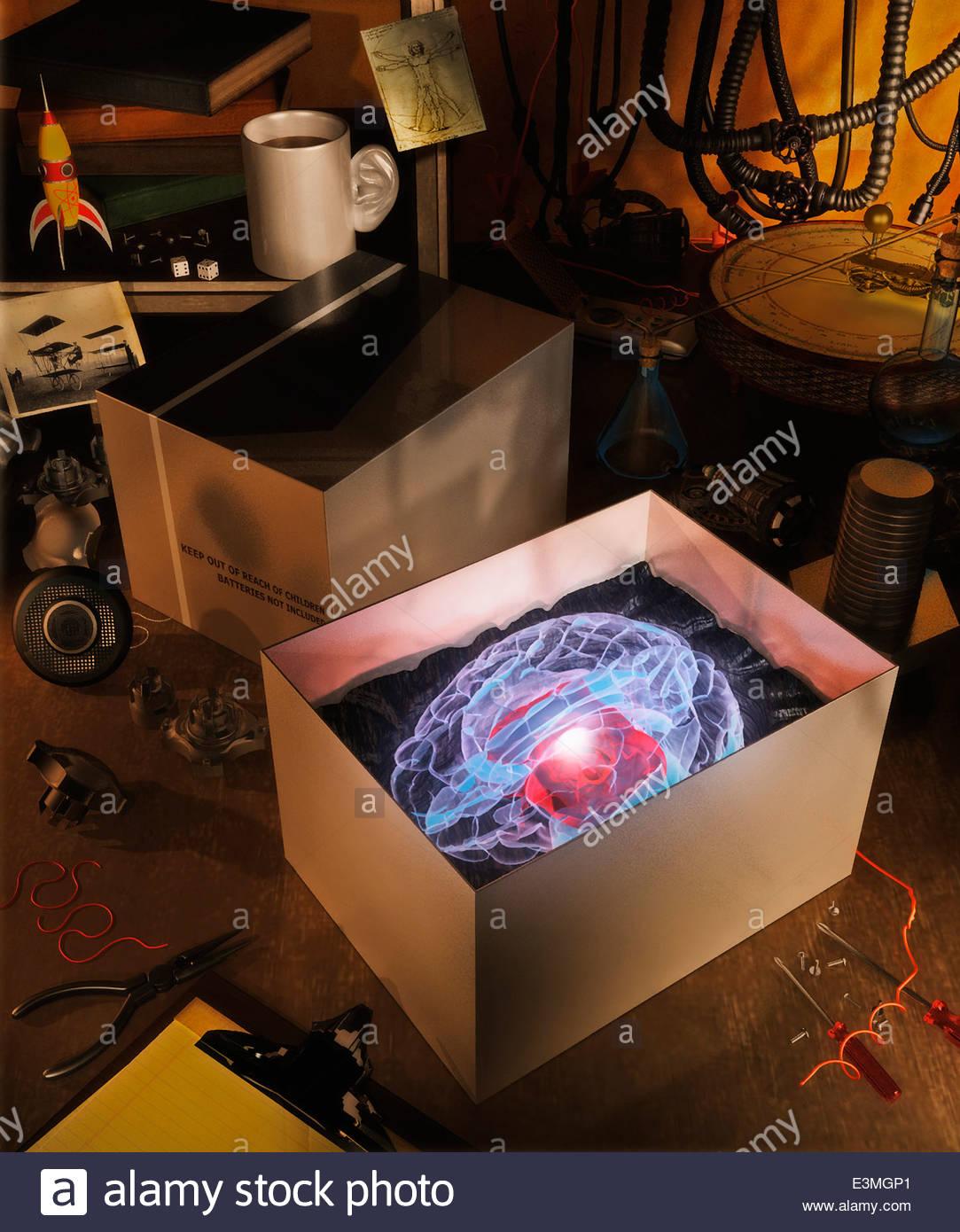 New glowing brain in box on workbench - Stock Image