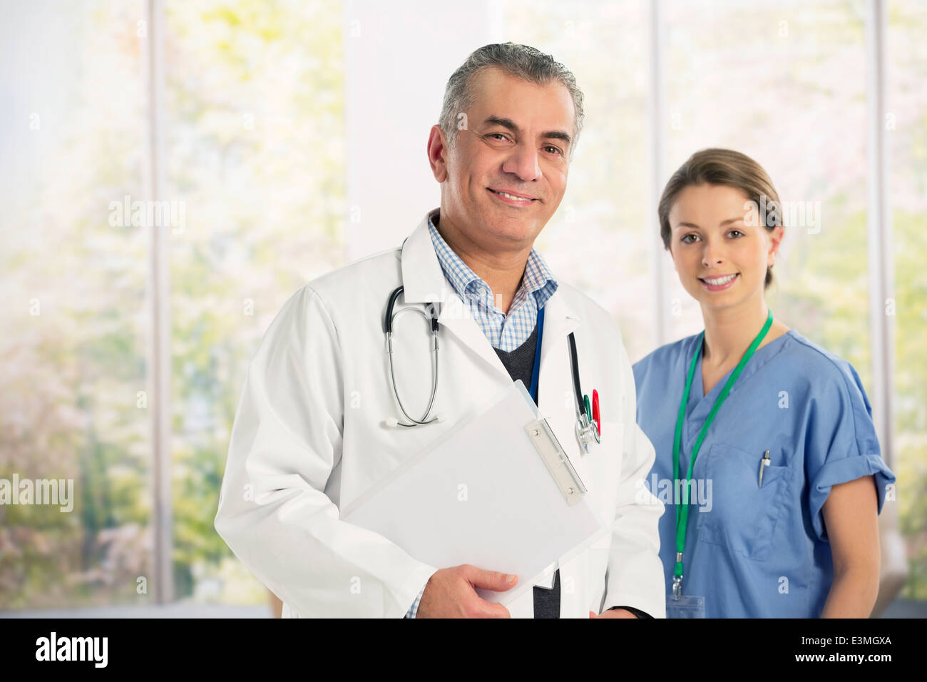 Portrait of confident doctor and nurse Stock Photo
