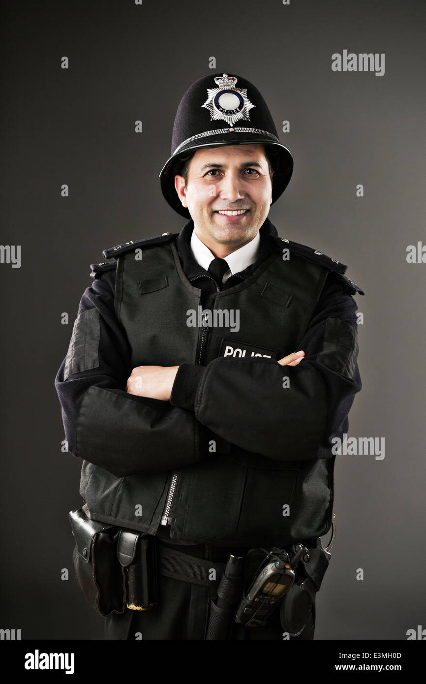 Portrait of confident policeman - Stock Image