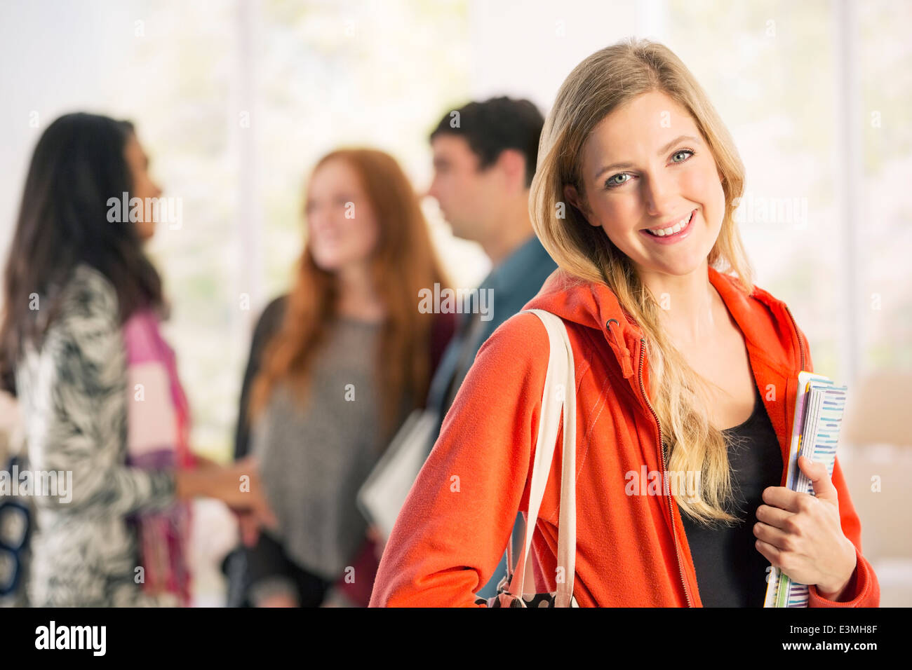 Portrait of smiling college student - Stock Image