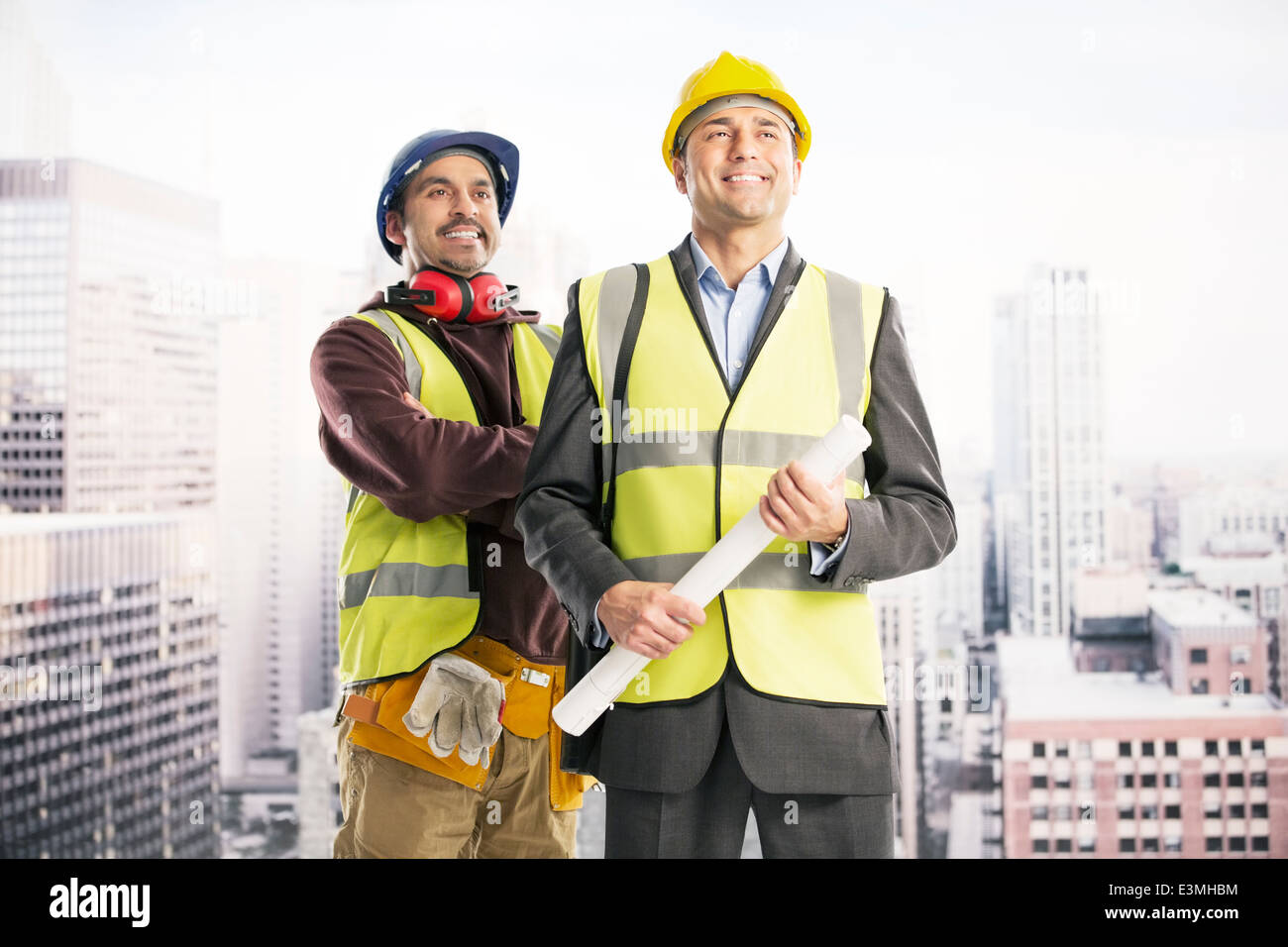 Construction workers in urban window - Stock Image