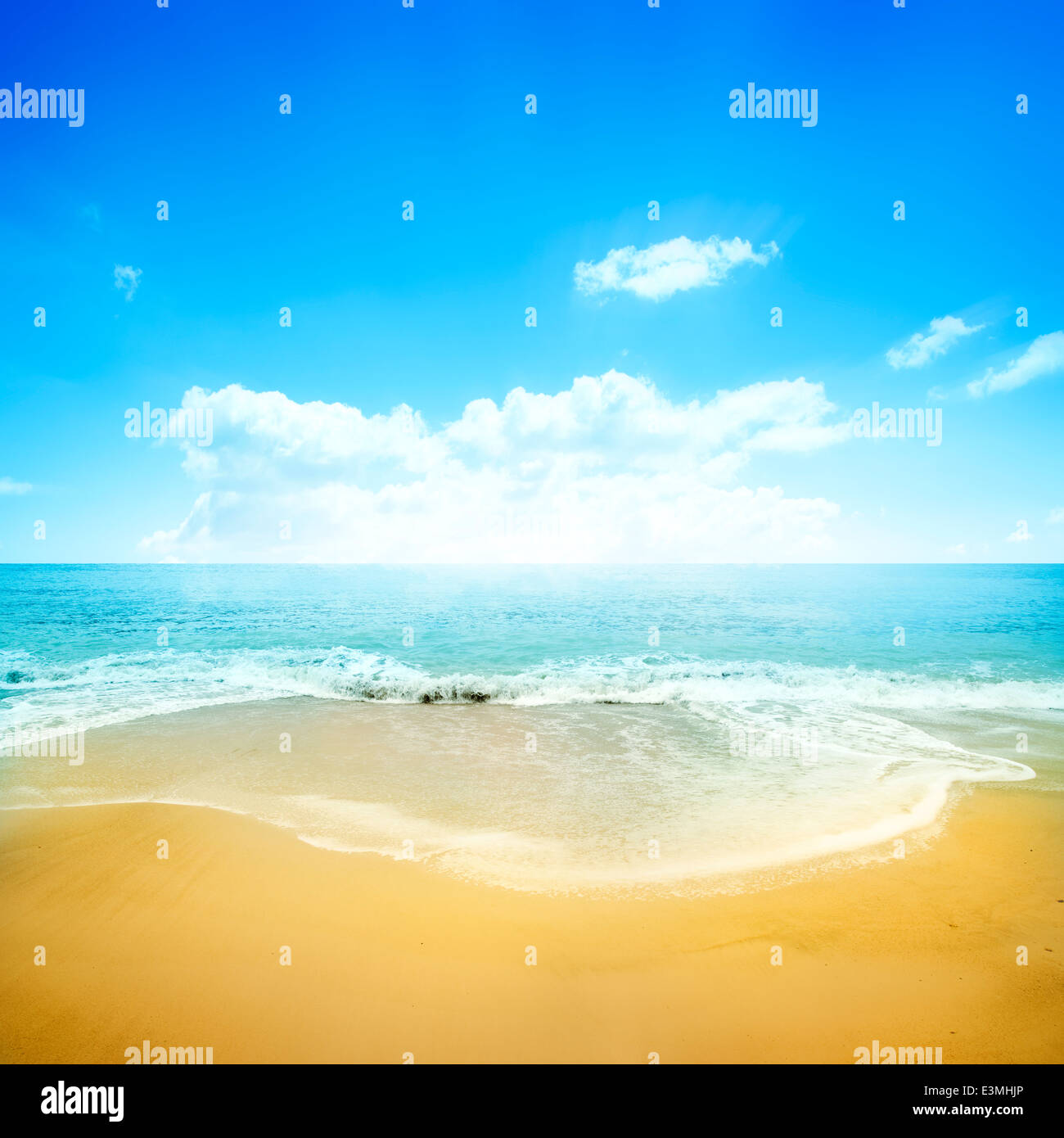 A golden sand beach and clear blue sky. Summer holiday background. - Stock Image