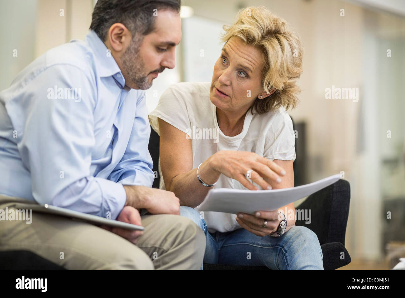 Businesspeople with document planning strategy in office meeting - Stock Image