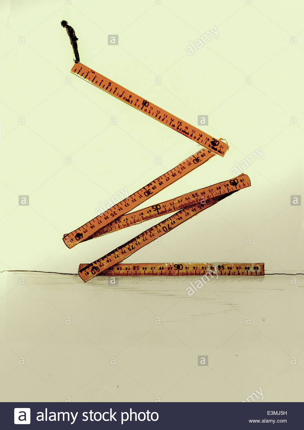 Businessman standing high up at the edge of folding ruler - Stock Image