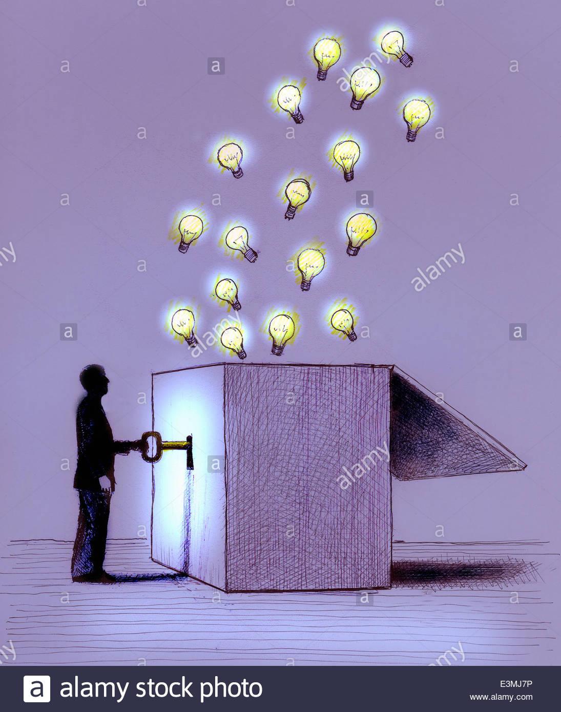 Man unlocking illuminated light bulbs from box - Stock Image
