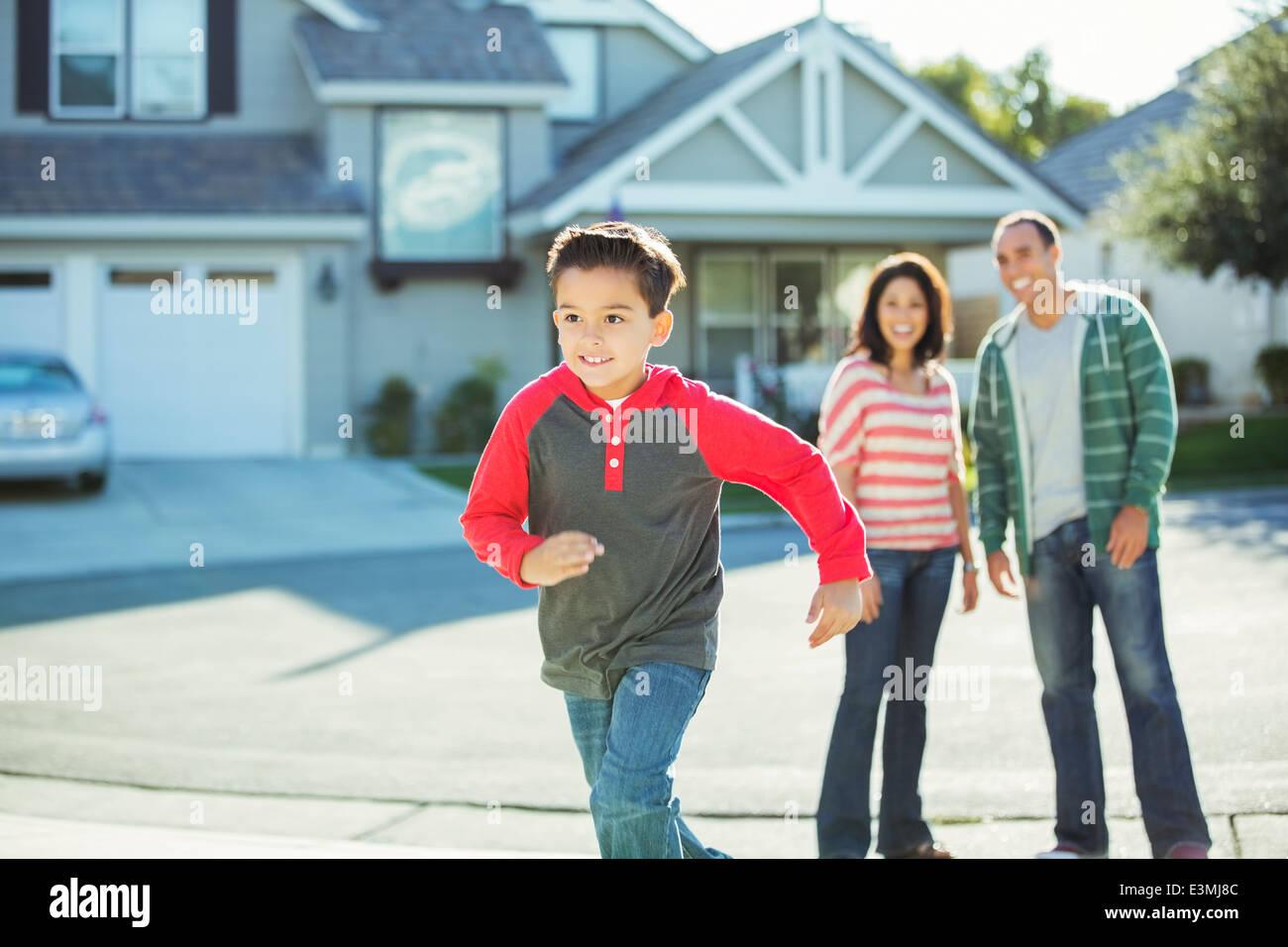 Boy running outdoors Stock Photo